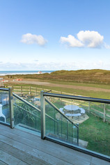 The veranda overlooks the dunes and the ocean waves