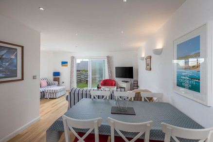 The open plan living space is decorated with a nod to the nautical