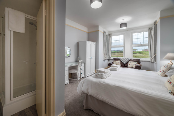 A large bedroom with countryside views
