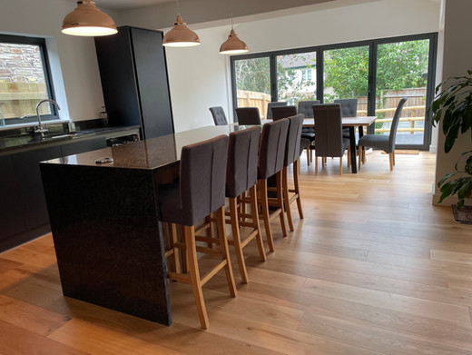 The modern kitchen and open-plan dining area