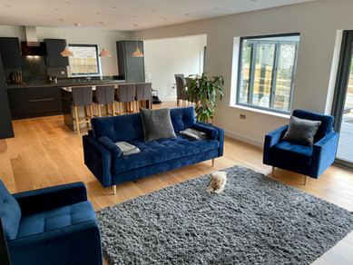 Sumptuous velvet sofa and easy chairs in the open-plan living area