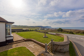 The lawned garden enjoys spectacular sea views