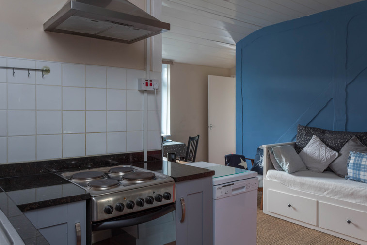 The fully-equipped kitchen area in Cottage 4.
