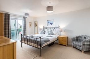 A light and airy double bedroom with metal frame bed