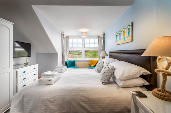 Your assured of a good night's sleep in this tranquil bedroom