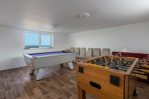 A pool table and table football mean that evening entertainment is sorted