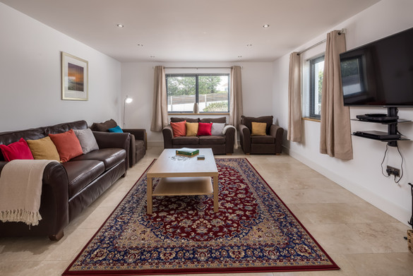 Living room with large sink-into sofas