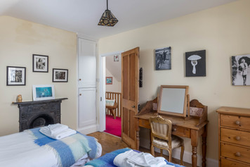A pretty twin room with quirky artwork adorning the walls