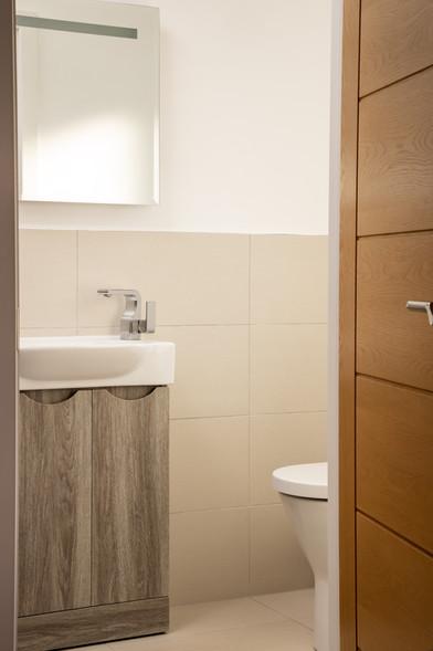 Sink, viewed through the bathroom door