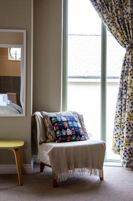 Bright soft furnishings add a splash of colour