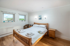 A double bedroom with views across the countryside