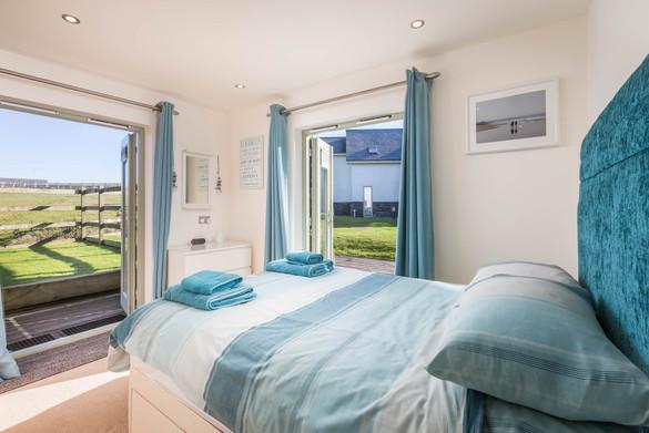 Ocean views inspire nautical bedroom decor