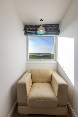 A picture perfect window with cosy chair; grab your book and enjoy