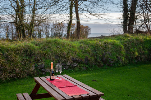 The garden table at Cottage 4 is the perfect place to enjoy a drink or an al fresco meal at the end of the day.