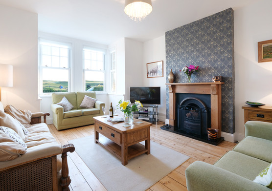 Relax amidst period features in the sitting room