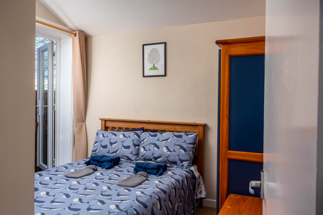 Cottage 3's double bedroom with doors to decking.