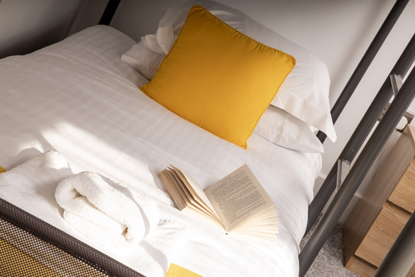 Crisp linen on single bed