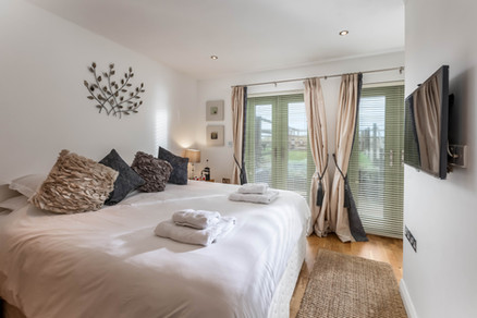 Bedrooms are decorated with earthy tones creating a feeling of calm