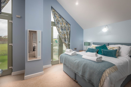 Views are expansive from this bedroom