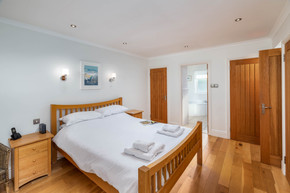 A double bedroom with crisp white linen