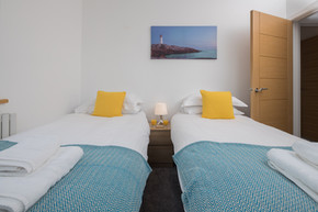 Twin room with artwork on the wall