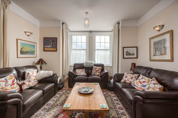 Plenty of space for all to kick back and relax and the three leather sofas
