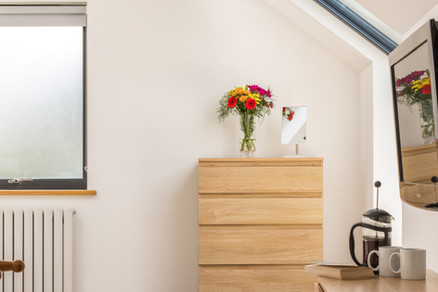 Chest of drawers with fresh flowers