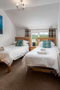 Twin bedroom with fresh linen