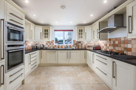 The large modern kitchen has plenty of space to cook up a storm