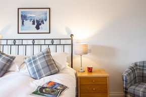 Treat yourself to a moment of calm in this double room with cosy armchair