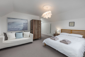 A large, stylish double bedroom