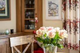 Fresh flowers adorn the dining table