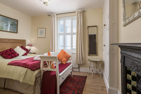 Traditional features are combined with modern comforts in the bedroom