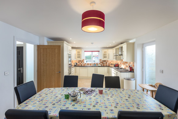Dine in style around this eight-seater table