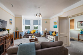 There is plenty of room to relax with three comfortable sofas in the sitting room
