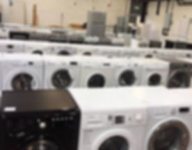 Rows of washing machines and cookers for sale