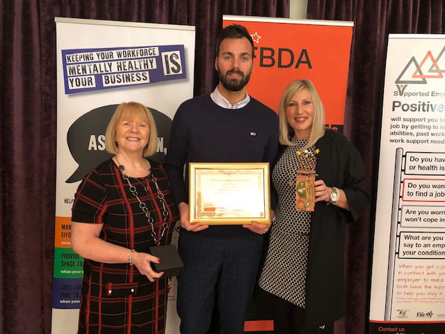Pete and Gail holding award with Fife Council employee