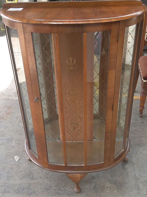 Kidney shaped display cabinet