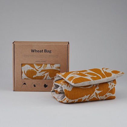 yellow and beige wheat bag next to packaging