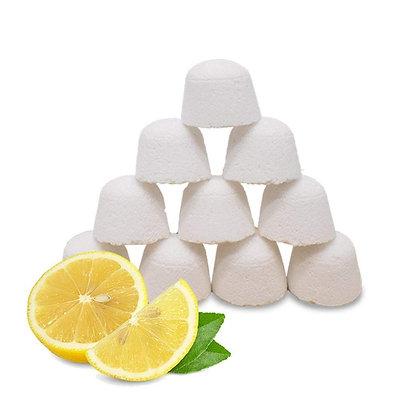 Stack of 10 toilet bombs behind some sliced lemon