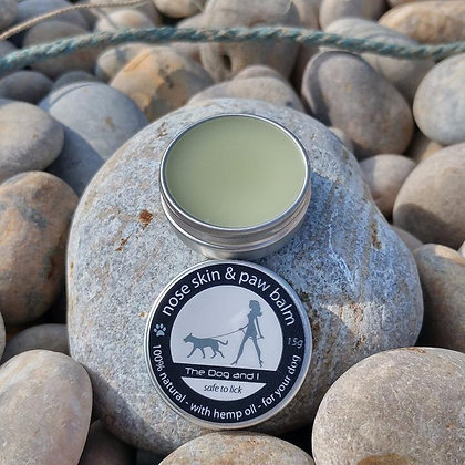 Nose skin and paw balm, open on a rock on a beach