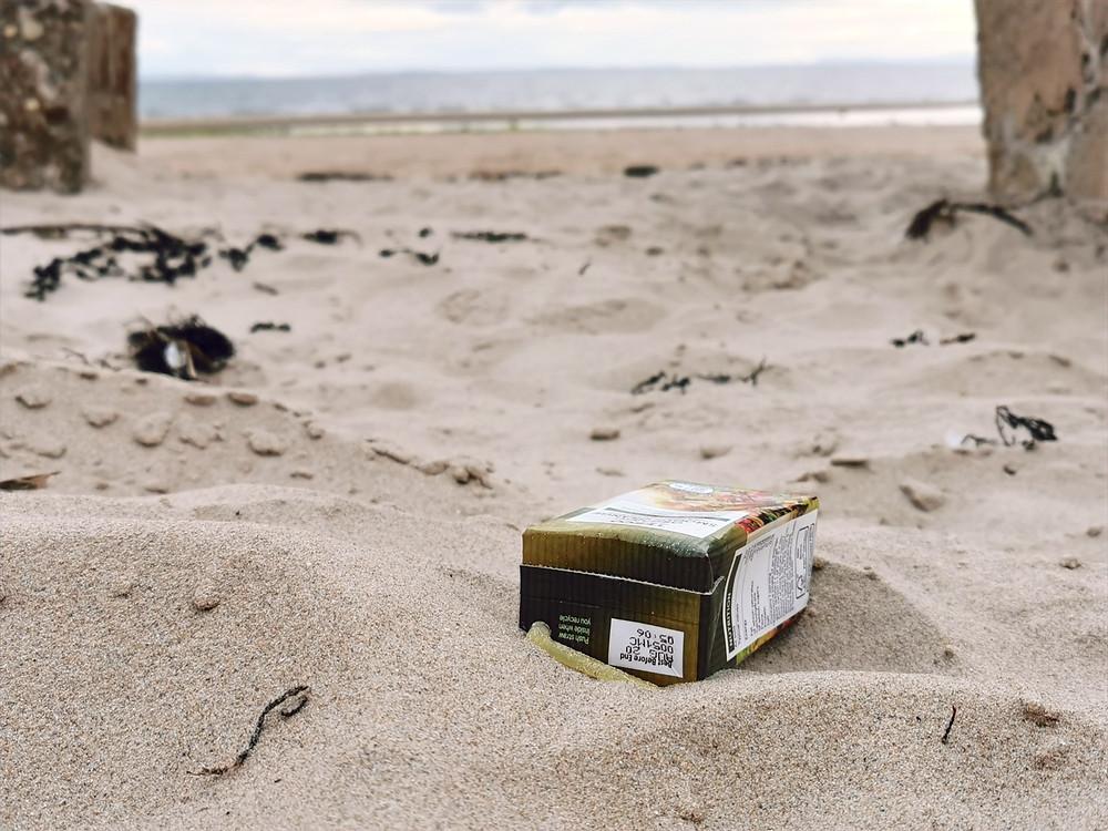 Plastic carton on a beach