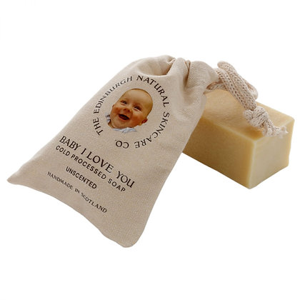 Baby soap in a small bag with a babies face on it