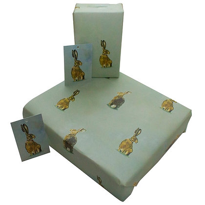 eco-friendly wrapping paper around a gift in oil hare design
