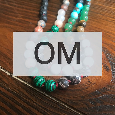 a picture of the grief meditation beads covered by a grey text box with the word OM.
