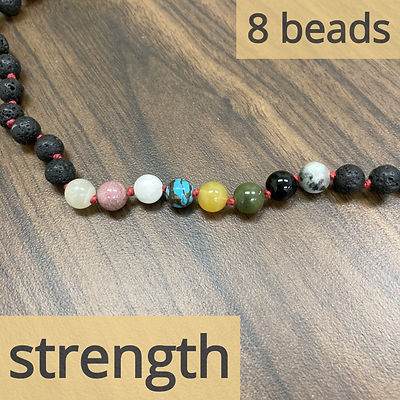 The section of eight colored beads that corresponds to the tarot card strength.