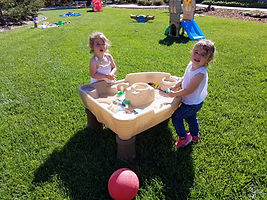 children playing outside with sand