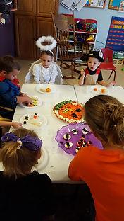 children at table learning social skills