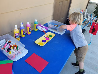 chiild playing finger paints