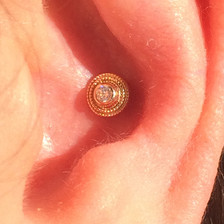 conch piercing with 14kt yellow gold